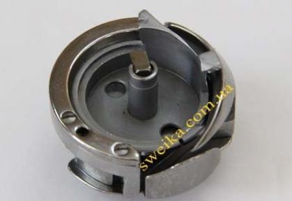 Човниковий пристрій для колонкової машини 9910